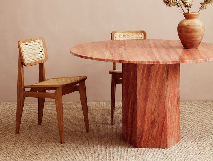 Gubi Epic Dining Table 1 red travertine Gam Fratesi